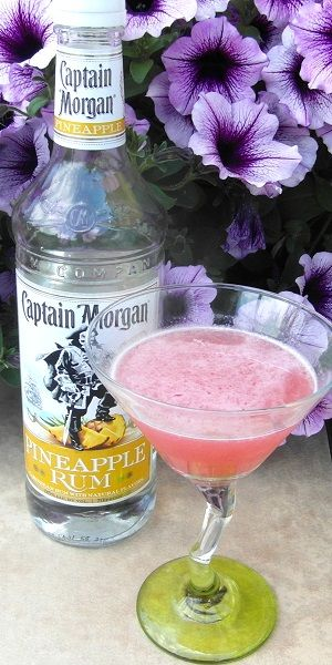 Jump the Shark 1 oz Captain Morgan Pineapple Rum 1 oz Captain Morgan Coconut Rum 1 oz Triple Sec 1 oz lime juice 1 oz Cranberry juice orange peel Shake all the ingredients over ice Strain into a co…