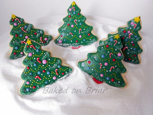 Christmas tree decorated sugar cookie. Royal icing. Green, pink, red, blue. Sanding sugar. Candy canes, ornaments, star, garland.