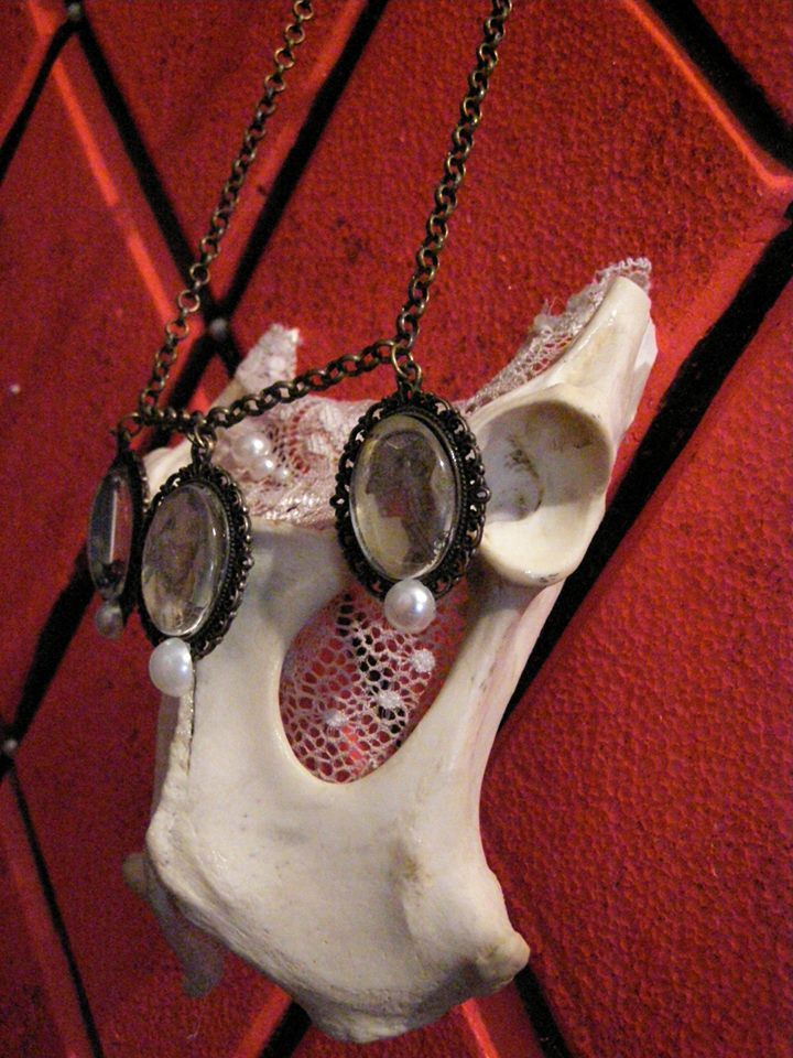 Bone pelvis cameo necklace.