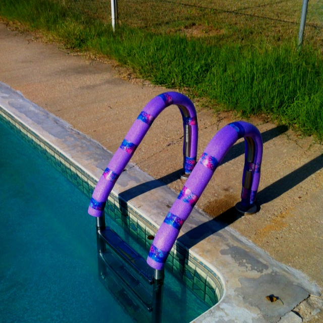 Our pool ladder gets so hot that it burns your hands making it difficult and uncomfortable when getting out. This idea came to me during one of my sleepless nights.  So many uses for Duck tape & Fun Noodles!!