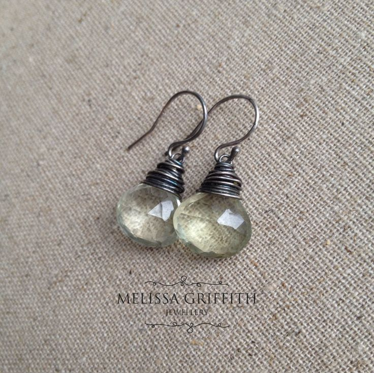 Green Amethyst Briolette Earrings (MGE88) $44.00 These sweet mint green amethyst (prasiolite) briolettes are sure to please! The gemstones have been wire wrapped with oxidized sterling silver wire for a rustic look. Earrings measure just over 1 inch from top of earring hook.
