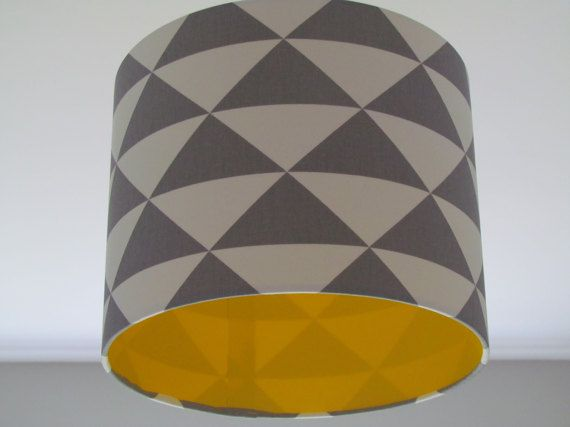 Handmade fabric drum lampshade / lightshade in a Grey and White geometric triangle design. The inside has been lined with a matt yellow vinyl for a real up to date look. Other colours available: Orange and White, Navy Blue and White, Black and White Lining colours available: Matt