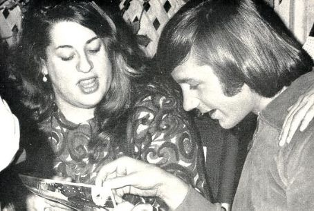 (Mama) Cass Elliot and Peter Tork (The Monkees).-  Peter Tork Played back up for the Mamas and the Papas when they were called the Mugwumps, before the Monkees.