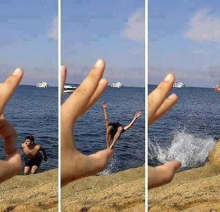 I love the way the photographer got a sequence of shots and was able to tell a little story about the dangers of big hands... or was it tiny bodies? It appears to me that the took the first shot with the finger curled and the subject poised to jump, and then took the next two shots with the finger extended and the jump and the splash to simulate the violence of the flick.