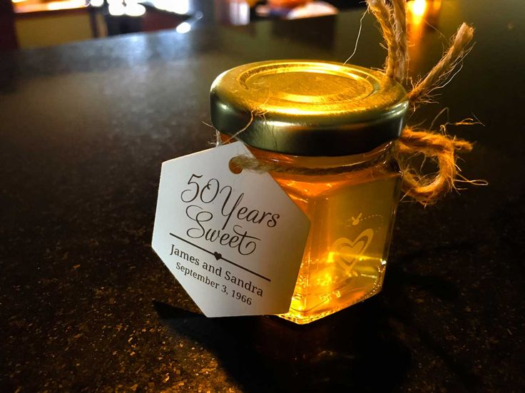 Celebrate a Golden Anniversary with our 'liquid gold' honey favors. This '50 Years Sweet' Honey Favor couldn't be more perfect for this couple's big wedding anniversary, and we think the gold color theme adds elegance and a classic look to the celebration, in addition to delighting guests who get to taste our all-natural E+M Wedding Favors wildflower honey.
