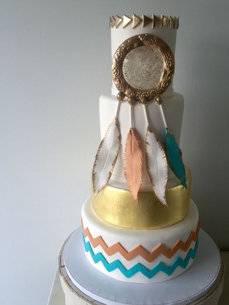 Feather Dreamcatcher Cake with edible gold leaf, chevron pattern and gold arrows. #sweetbabescakery