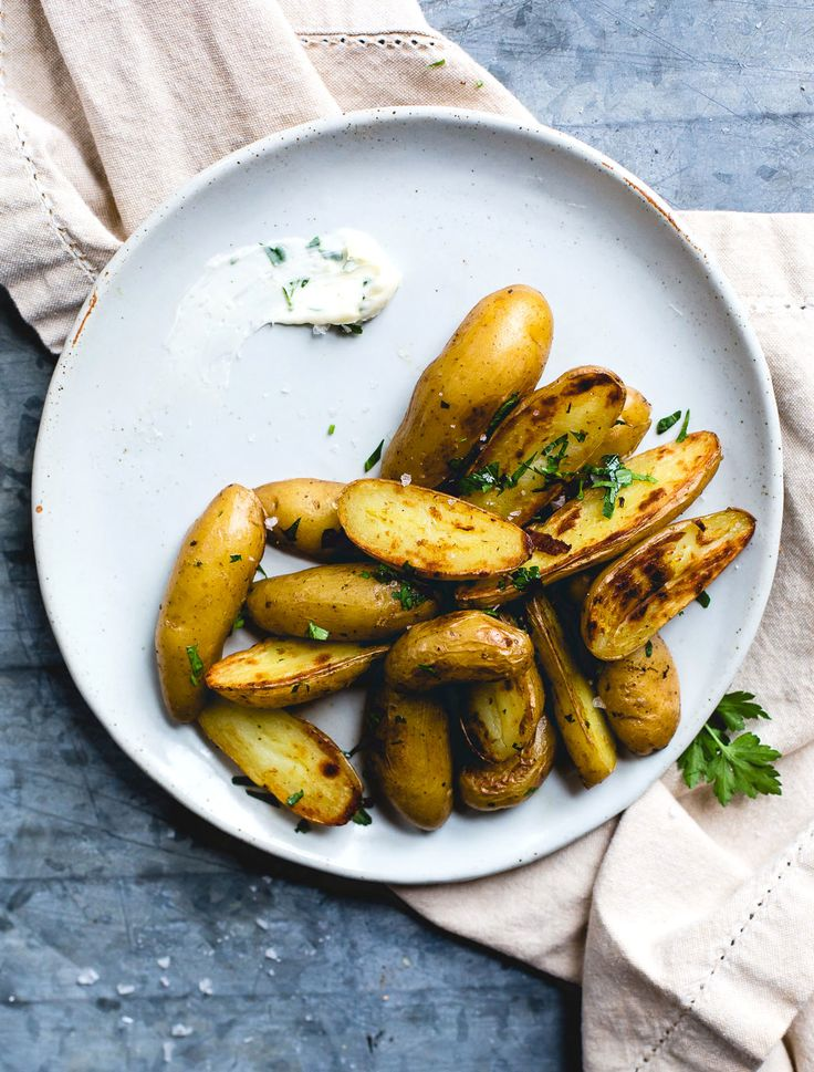 Organic potatoes, extra fresh garlic, and pastured butter actually make this a nutritious indulgent treat! -- Crispy Garlic Butter Fingerling Potatoes | heartbeet kitchen
