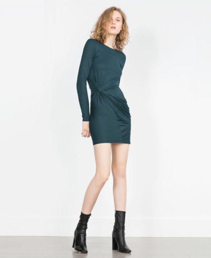 Teal green dress.