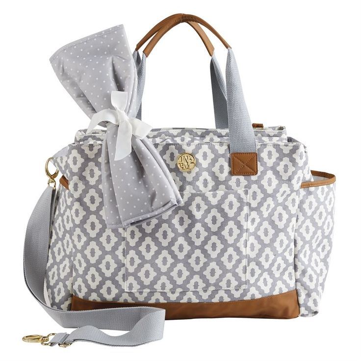 2-piece set. Large, treated cotton canvas diaper bag features roomy interior and exterior pockets, key-finder clip and coordinating, wipe-clean nylon changing pad.
