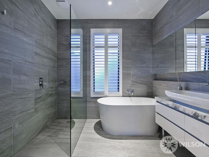 Light floor tiles dark wall tiles modern bathroom design for Ensuite lighting ideas
