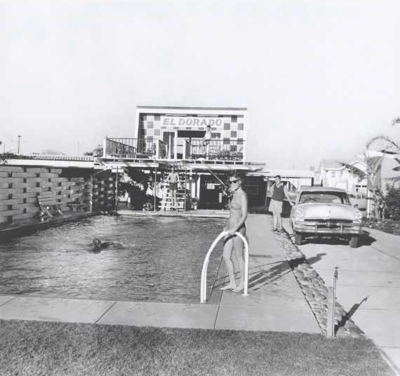 Woman by the swimming pool with car and El Dorado Motel office behind her, Gold Coast, ca. 1950s
