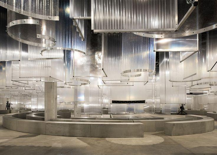 "AMO installs translucent ""stalactites"" above Prada Spring Summer 2016 catwalk."