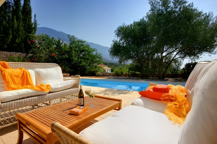 A glass of wine and a good book is all you need to enjoy an afternoon by the pool at Villa Telina.