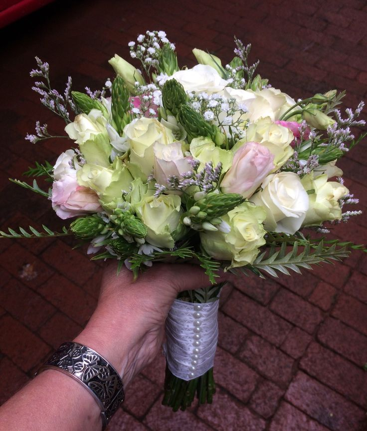 Bridal bouquet with roses, chinx and lisianthus.