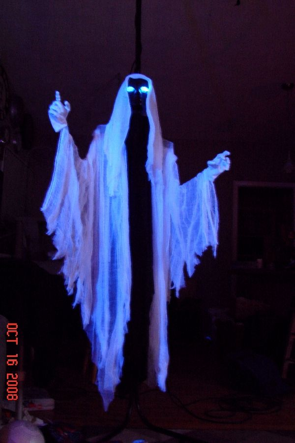 It has a foam head painted black and blue LED's inserted from the back leaving the foam undisturbed in the front. Black fabric was zip tied around the neck and just run straight downthen the cheese cloth was draped over the shoulders and trimmed coarsely at the bottom.