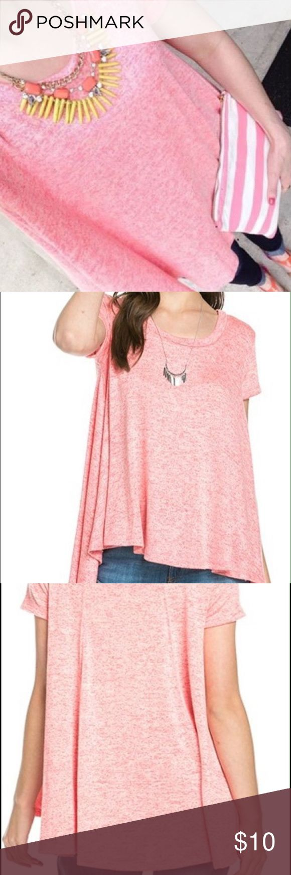 """NWOT Women's High Low Pink T-Shirt Boutique item. Super cute bright pink t-shirt with scoop neck. Shorter in front and longer in back. 77% rayon, 21% polyester, and 2% spandex. Hand wash cold gentle cycle and line dry. Approximate measurements: Medium - 21"""" armpit to armpit when laid flat; 25"""" long in the front; 30.5"""" long in back. Large - 22"""" armpit to armpit when laid flat; 25"""" long in the front; 31.5"""" in back. Recommend ordering normal size. From a smoke-free, pet-free building. Tops Tees…"""