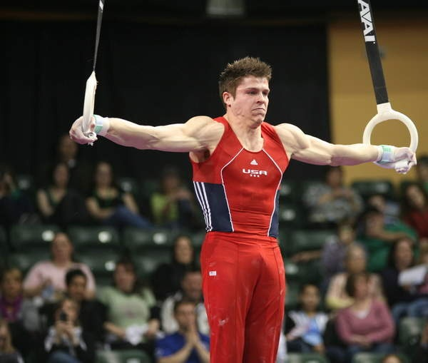 Chris Brooks holds an iron cross on the still rings during the 2012 Kellogg's Pacific Rim gymnastics meet on his was to winning the all-around title.