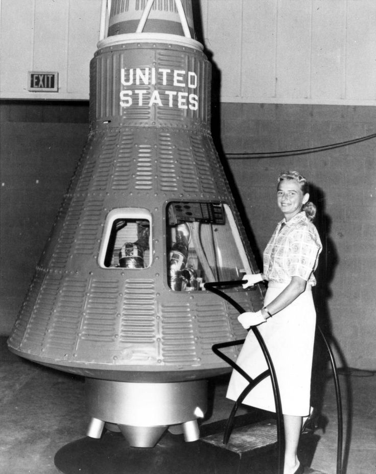 Jerrie Cobb poses next to a Mercury spaceship capsule. And, although she never flew in space, Cobb, along with 24 other women, underwent physical tests similar to those taken by the Mercury astronauts with the belief that she might become an astronaut trainee. All the women who participated in the program, known as First Lady Astronaut Trainees (FLAT), were skilled pilots.
