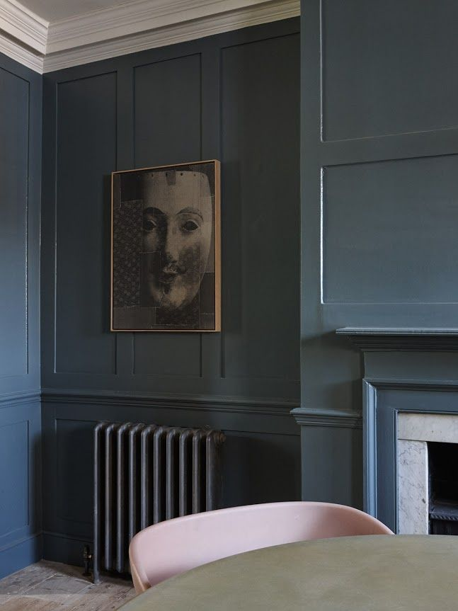 Everything painted in the same colour, walls, radiator, fireplace. Beautiful real colour.