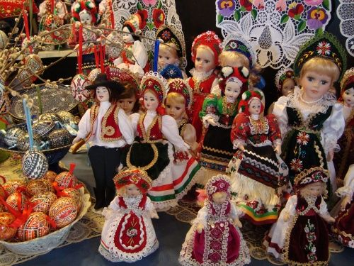 Hungarian folk art and crafts for sale at a market. Items such as pottery, carved wood, dyed Easter eggs, and woven cloths are associated with Hungarian folk art.