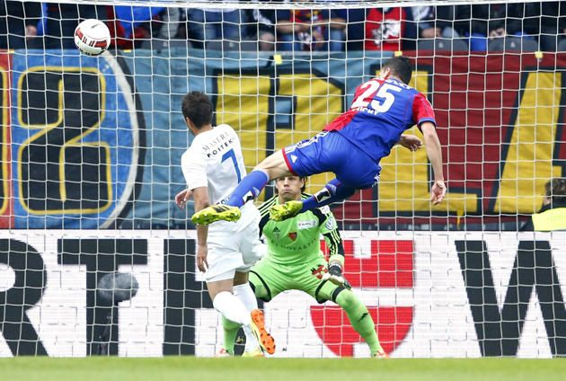 FC Basel's Marek Suchy (R) fights for the ball with FC Zurich's Mario Garanovic (L) in front of FC Basel's goalkeeper Yann Sommer during their Swiss Cup final soccer match in the Stade de Suisse stadium in Bern April 21, 2014.