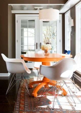 orange table, white chairs: doing this in my next apartment. already on the flea market hunt for a good solid round wooden table.