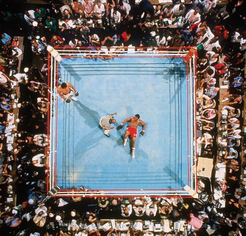 """Muhammad Ali defeats George Foreman at the famous 1974 """"Rumble in the Jungle"""" in Kinshasa, Zaire. (Neil Leifer/SI)"""
