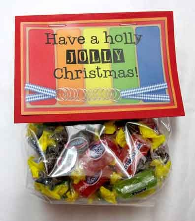"Holly Jolly Christmas  Fill craft baggies with Jolly Rancher Candy and attach a topper that says,  ""Have A Holly Jolly Christmas!"" Add a snowman graphic on the topper."