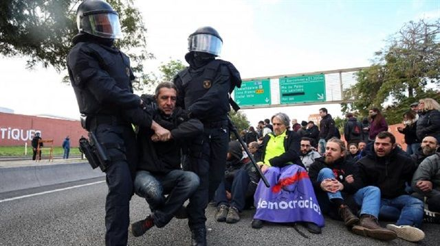 Catalan strike severs road links as secessionist leaders regroup /  Protesters shut down roads, causing huge tailbacks into Barcelona, and some public transport ran minimum services