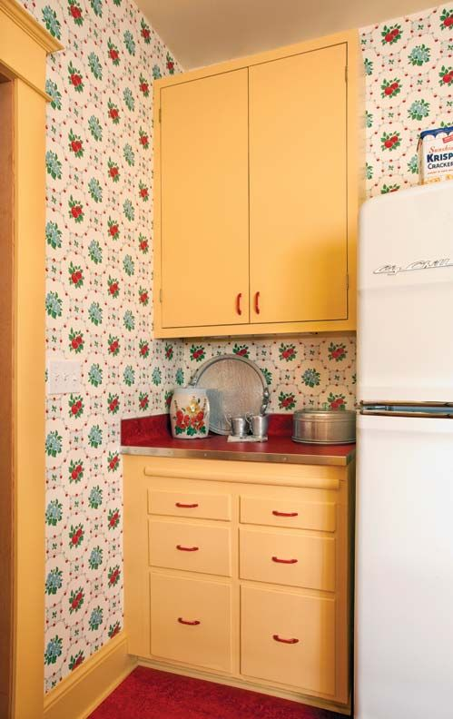 The sunny yellow cabinets and red Marmoleum flooring and countertops are a great fit with the Bradbury & Bradbury wallpaper. (Photo: Blackstone Edge Studios)