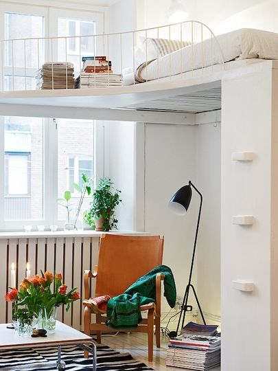 I've seen lots of really inspring loft spaces, but I've never seen one with its own Juliet balcony before. Jules over at The Diversion Project in Australia found this incredible one. I love how the elegant balcony adds extra space for her magazines and books, and also creates a cozy reading nook underneath.