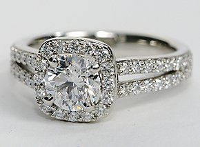Eyes will be fixated on this immaculate platinum engagement ring, showcasing a halo design and 48 pavé-set round diamonds. #bluenile