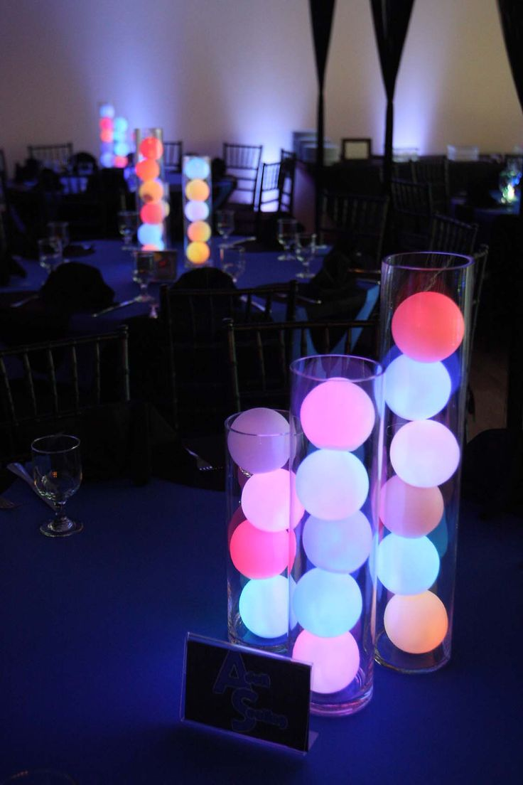 Color Changing LED Deco Balls stacked in glass cylinder vases makes for super cool DIY light up table centerpieces, ideal modern wedding decor. Our LED orbs are perfect for this: http://www.flashingblinkylights.com/mood-light-garden-deco-balls-floating-light-up-orbs.html?utm_source=Pinterest&utm_medium=Deco%20Balls&utm_campaign=LED%20Wedding%20Decor