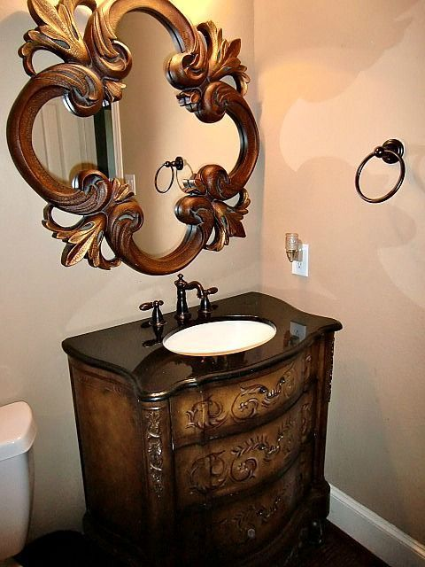 """For those that know me, you know that I love to decorate on a budget.  I search estate sales, yard sales, furniture consignment stores, antique stores all the time looking for unique pieces.  I """"scored"""" this ornate mirror & marble top vanity last weekend on an internet yardsale site (family was remodeling the bathroom in their newly purchased home)!  My husband did all the plumbing and electrical work.  I think I'll keep him!  ;-)  This half bath previously had a pedestal sink which I…"""