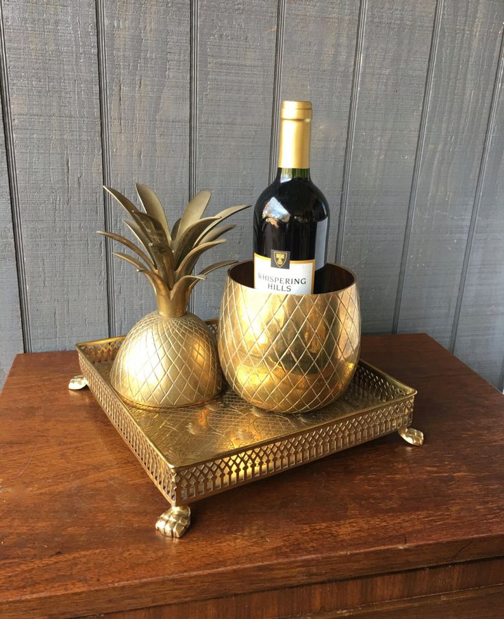 Fantastic midcentury brass pineapple container, large and hard-to-find. Perfect for your Hollywood Regency decor, and a great way to welcome your guests.  Condition: Great vintage condition with just the right patina The top fits on well, making it perfect for use as an ice bucket or large container. The inside is clean and ready for use. Measures 13 tall x 5 1/2 wide across the top.  If you need additional photos, don't hesitate to ask.  Please read my shop policies before purchasing. Any…