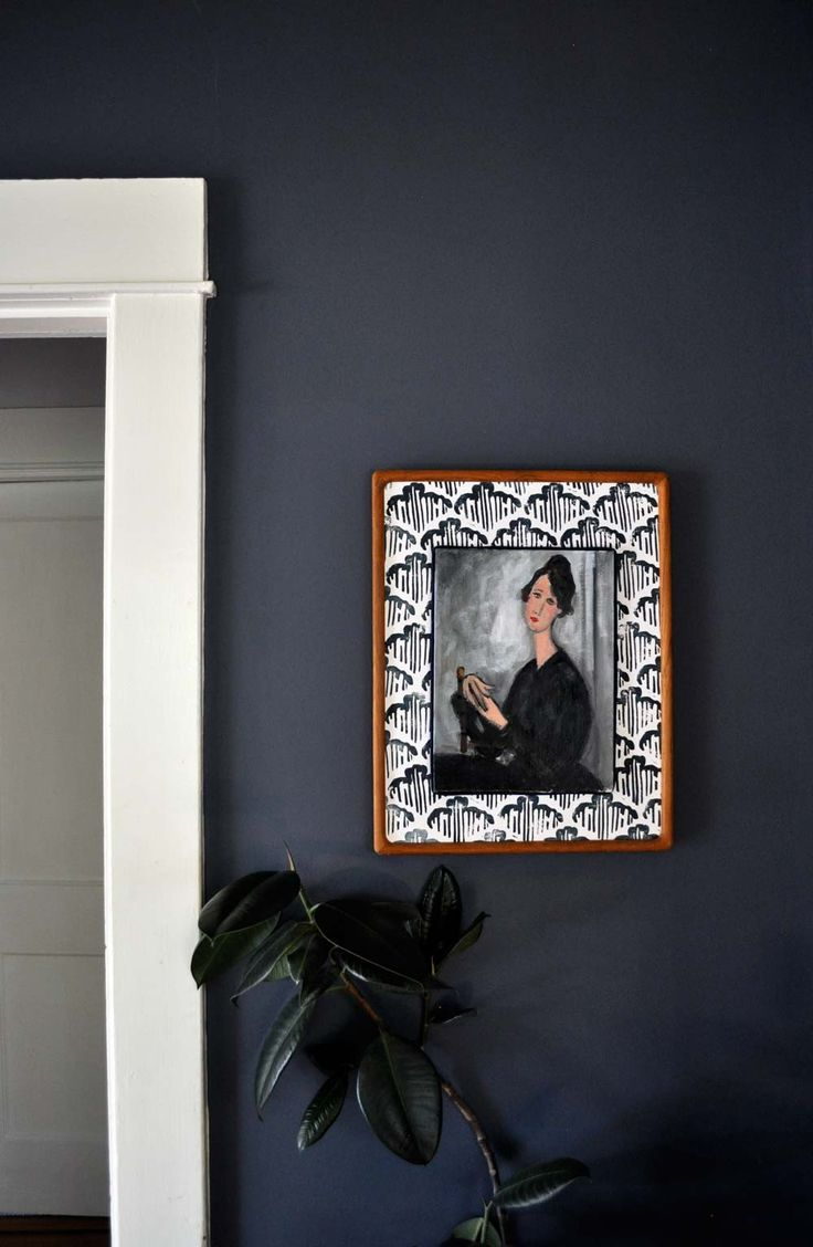 In the dining room, Katie matted an oil painting from eBay with a hand-stamped pattern reminiscent of her favorite Farrow & Ball wall covering.