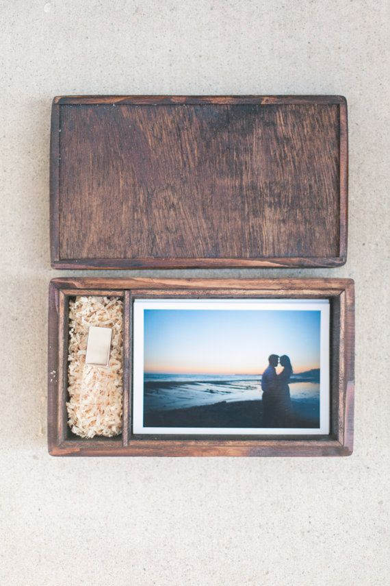 Celebrate your love by filling up a USB of your life together and include the print copies too in this photo box that holds up to 100 4x6 photos. Handmade by RyansDenn.