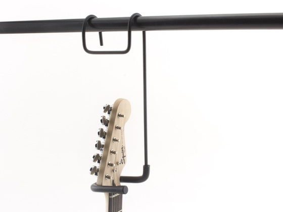 The New Closet Guitar Hanger. This is a great idea except my wife owns about 90% of our closet.. Adding to wish list!!!