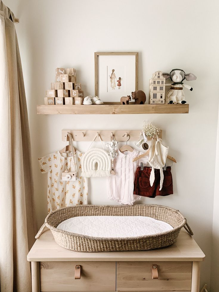 Neutral nursery with browns and whites and wood tones