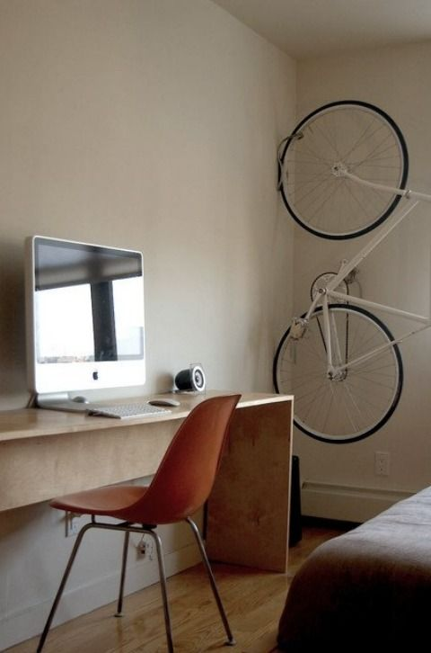 A timeless Eames Molded Plastic Side Chair with 4-leg Base helps keep things simple in Jeremy's apartment, also in NYC