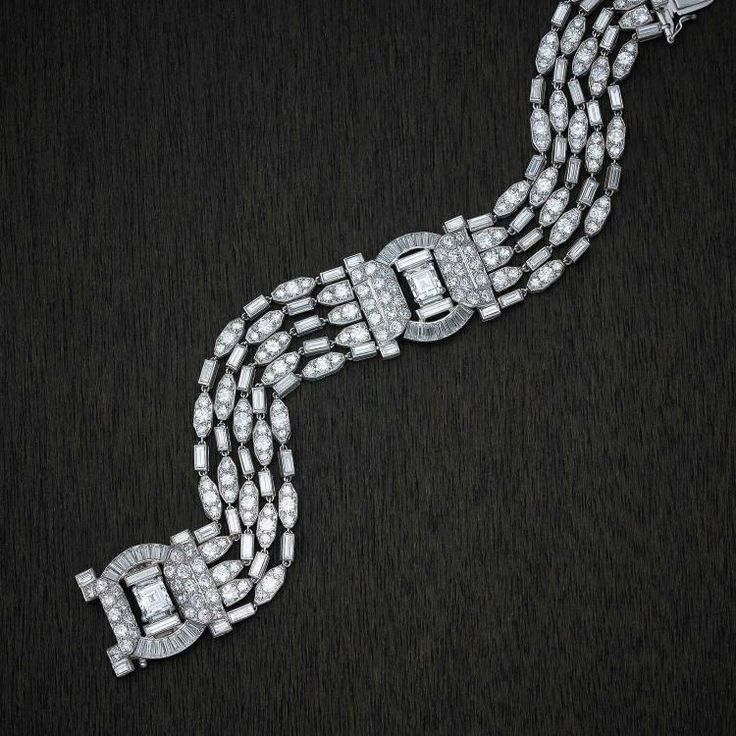 Buy online, view images and see past prices for An important Art Deco diamond bracelet, Cartier, London, circa 1930's. The five strand bracelet collett-set with two square step cut diamonds, eighty-eight baguette diamonds, one-hundred and one brilliant cut diamonds and eighty-one single cut diamonds of estimated total weight 20 carats. Platinum. Weight 59.87 grams. Length approximately 17.50cm. Engraved signature Cartier London Pat.No. 434066. Stamped 388.   . Invaluable is the world&#...