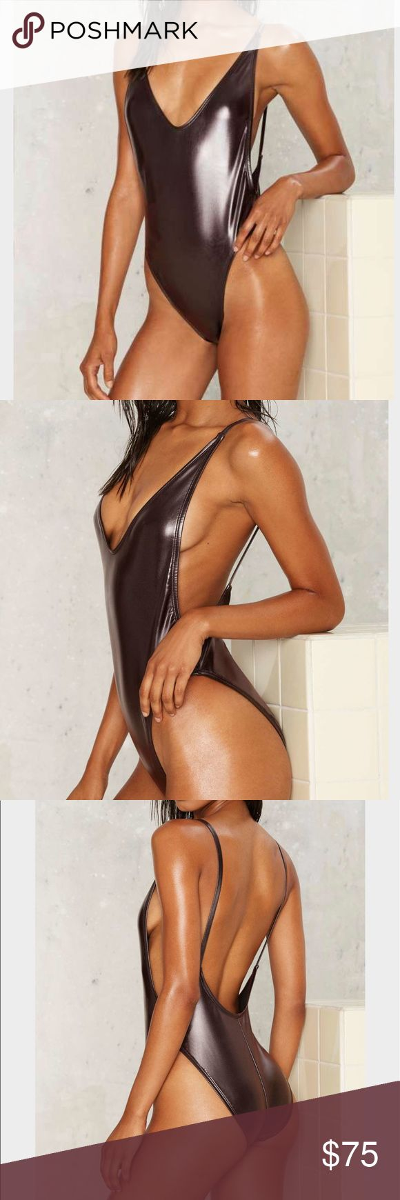 Nasty Gal Wet's The Idea Metallic Swimsuit -Bronze Love a good liquid look. The Wet's the Idea Swimsuit features a bronze liquid metallic body, plunging neckline, scoop back, high and low sides, and a medium coverage bottom. Fully lined. By Nasty Gal. Nasty Gal Swim One Pieces