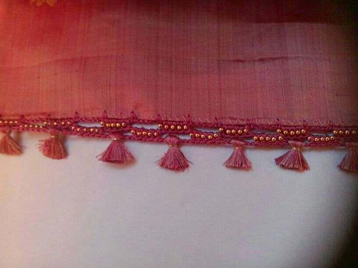 Pink colour saree tassels will give an elegant look to the saree