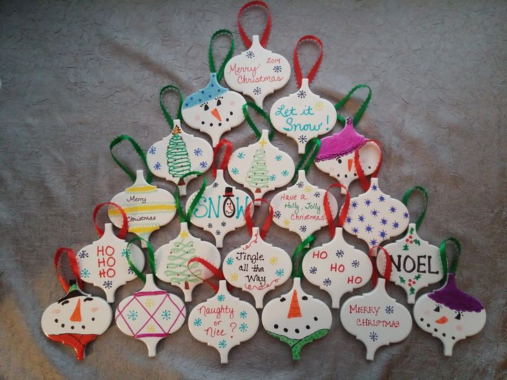 Christmas Ornaments - Ceramic tiles from Lowe's, Sharpie markers, a ribbon loop, a felt oval on the back, and a hot-glue gun.