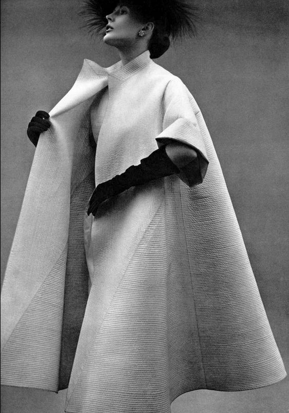 1951 Model in white satin coat, minutely and finely quilted, over white dress with same quilted yoke by Lanvin-Castillo, photo by Pottier