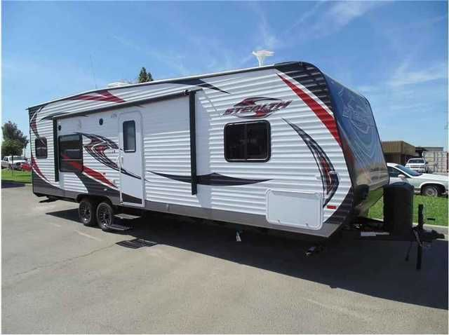 2015 New Forest River STEALTH WA2715 Toy Hauler in California CA.Recreational Vehicle, rv, 2015 Forest River STEALTH WA2715, 2015 Stealth 2715 fully loaded included 160 watt solar power. Stealth is the number one selling toy hauler in America and they are well engineered, constructed and backed with the best warranty in the business. The 2715 is Stealths flagship toy hauler and is 1/2 ton towable.The front bedroom has a full walk around queen size bed, wardrobe closets, under bed storage and…