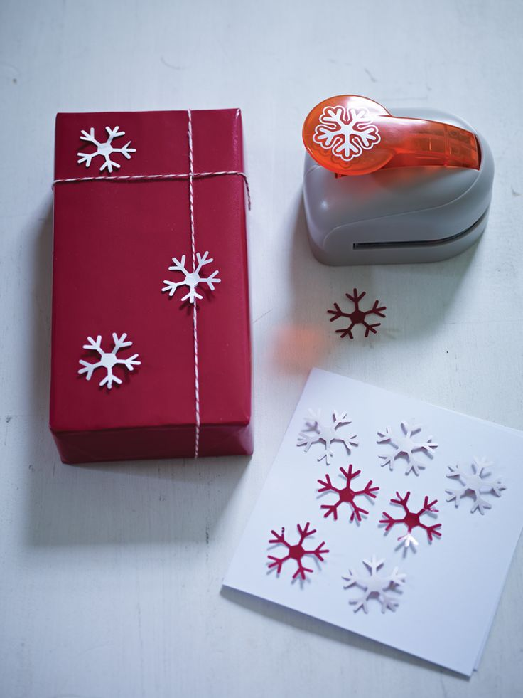 snowflake hole punch, makes 3d snowflakes in the paper you punch and could use the little snowflake it cuts out for confetti!