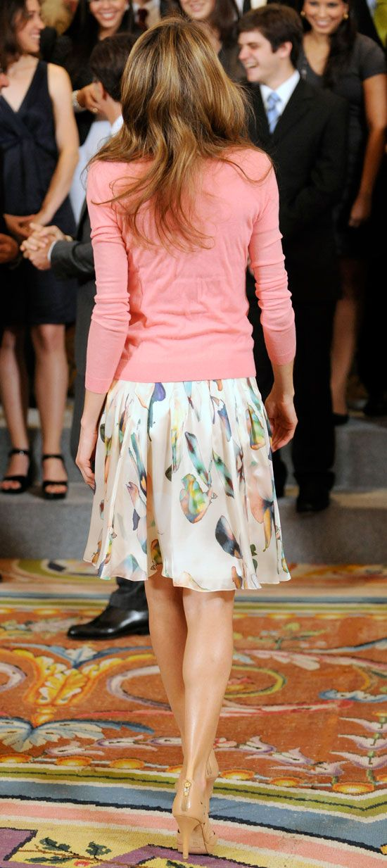 17 July 2014 - Francisco de Vitoria University Europe Scholarships. Hugo Boss watercolour silk skirt and salmon pink cami/cardigan twin set.