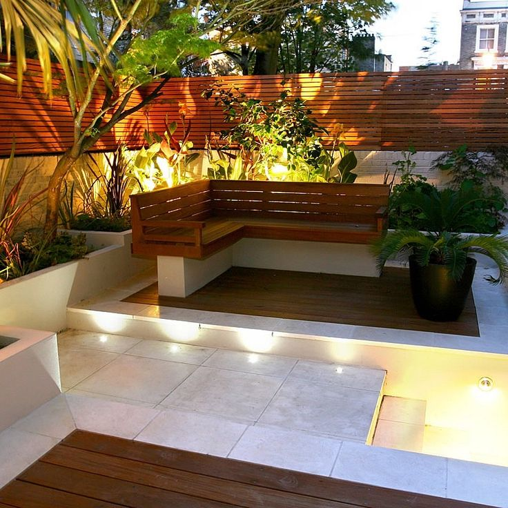 contemporary chic garden slatted hardwood trellis by ben molyneux led lighting and neat limestone paving - Garden Ideas Lighting