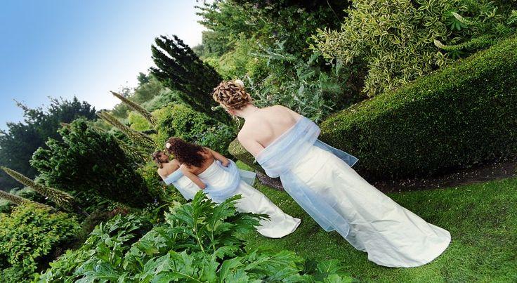 Bridesmaids making their way down the long walk at Parkside Gardens Oamaru New Zealand